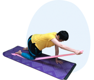 woman exercising using resistance band on mat