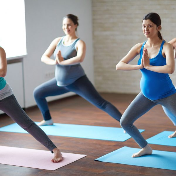 pregnant women in pilates class studio