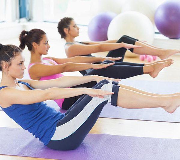 women-on-mat-in-pilates-class